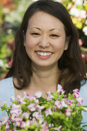 Woman smiling and receiving flower arrangement